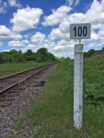 end of a long day: Mile post  railway with the number one hundred