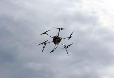 mounted: Flying  drone in the sky with mounted  digital camera.