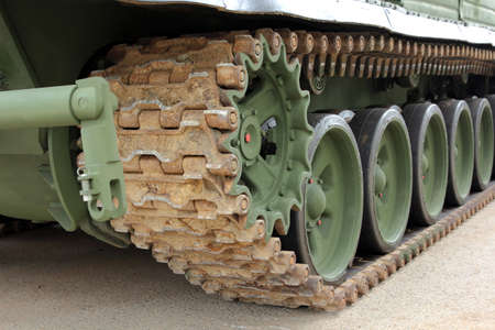 undercarriage: Part of the undercarriage of tracked military equipment, close-up