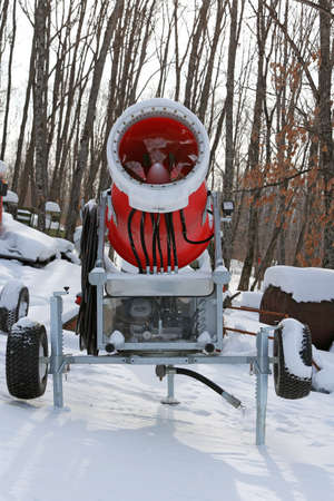 snow grooming machine: Snowmaking is the production of snow  on ski slopes. Stock Photo