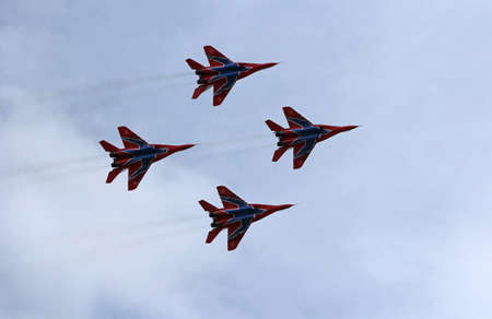 supersonic: BARNAUL, RUSSIA - AUGUST 16, 2015: Aerobatic Team Russian Knights at WorldWide AirShow in Barnaul, Russia. Editorial