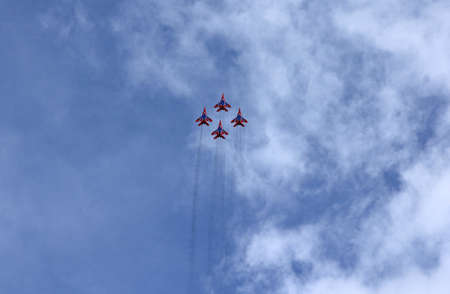 supersonic transport: BARNAUL, RUSSIA - AUGUST 16, 2015: Aerobatic Team Russian Knights at WorldWide AirShow in Barnaul, Russia. Editorial