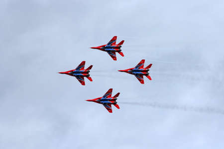 aerobatic: BARNAUL, RUSSIA - AUGUST 16, 2015: Aerobatic Team Russian Knights at WorldWide AirShow in Barnaul, Russia. Editorial