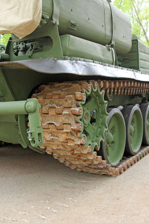 tracked: Part of the undercarriage of tracked military equipment, close-up
