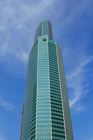 Modern buildings of glass and steel skyscrapers against the sky.