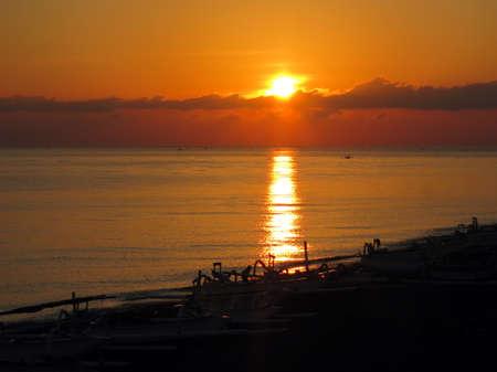 sunset in ocean Bali Stock Photo