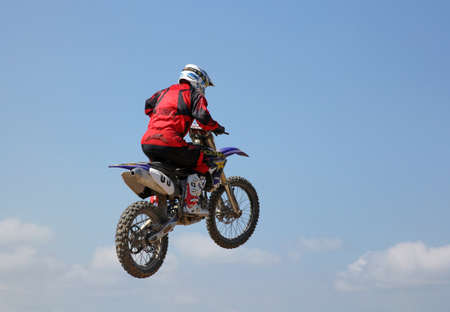 motorcross: ARSENYEV, RUSSIA - AUG 30: Rider participates in the  round of the 2014 Russia motocross championship on August 30, 2014 in Arsenyev, Russia.
