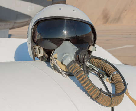 Helmet and oxygen mask of a military pilot. Stock Photo