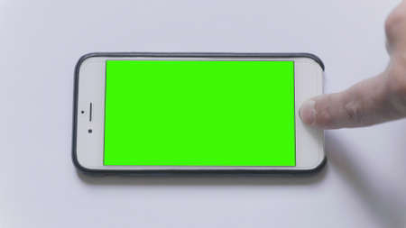 MOSCOW - JUNE 3, 2017: firmware updatethe Apple iPhone on a white background green screen in Russia on June 3, 2017 in Moscow, Russia.