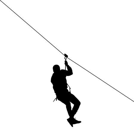 Silhouette of a man riding a zip line