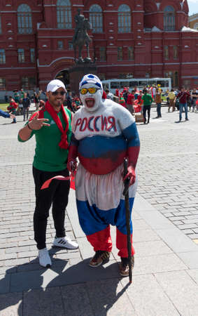 MOSCOW - JUNE 20, 2018: Soccer World Cup Fanatics of Morocco, Russia with flags with their typical costumes in the streets June 20, 2018 in Moscow, Russia
