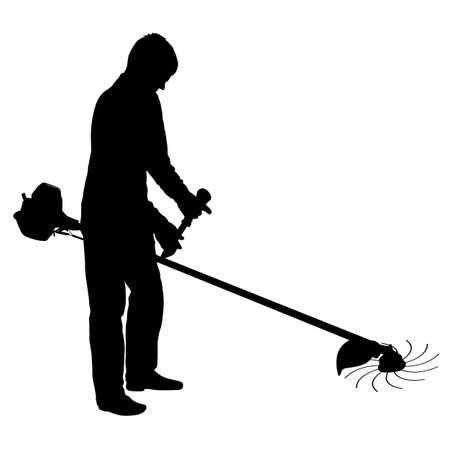 Silhouette worker of a garden cuts off grass.