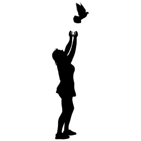 Silhouette girl releases doves into the sky.