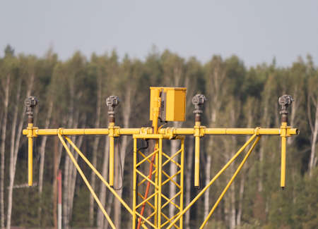 Yellow metal support systems of care during takeoff and landing direction light near runway.