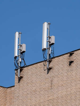 Mobile communication antennas on the wall of a building.