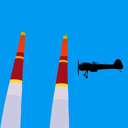 Aerobatic aircraft performs aerobatics against the sky.