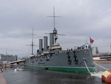 ST. PETERSBURG, RUSSIA, May 10, 2018: The Cruiser Aurora. The ship is moored at Petrogradskaya embankment and is a Museum. On the nose set naval flag of Russia. Publikacyjne