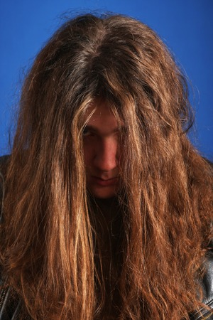 Man with long hair frustrated photo