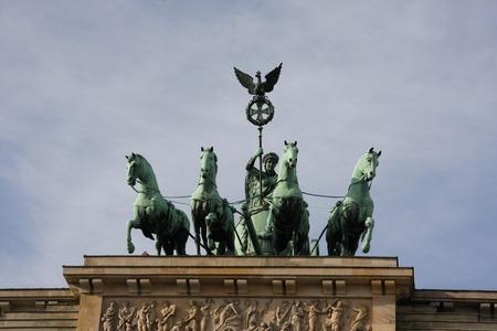 quadriga: Quadriga on the top of Brandenbrurg gate in Berlin, Germany Stock Photo