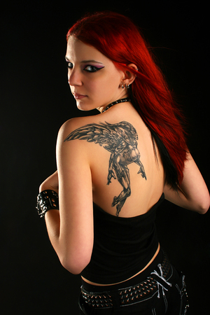Sexy red hair girl with beautiful tatoo photo