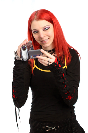 Teen recording with her video camera photo