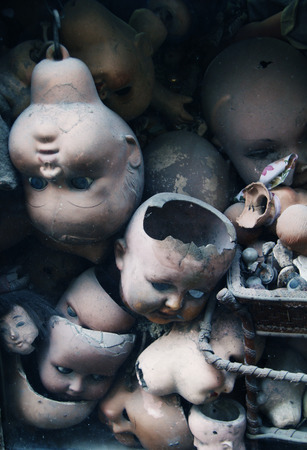 Scary dolls heads (with some white dust spots) photo