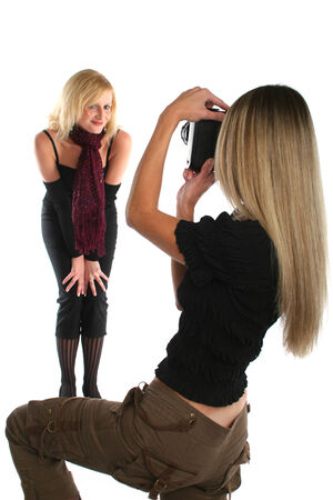 Beautiful felame photographer taking picture of a model photo