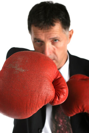 affraid: Bussines man with boxing gloves on
