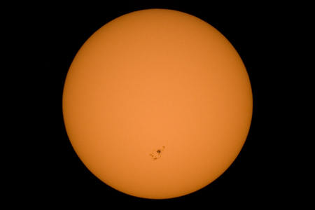 sunspot: Real picture of the sun with a big sunspot group.