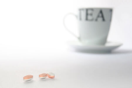 Tea cup and pills photo