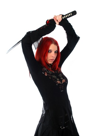 Beautiful red hair girl with katana sword photo