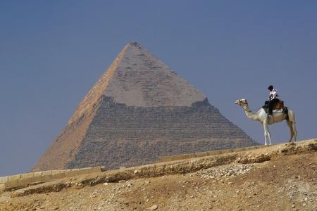 chephren: Pyramid of Khafre (Chephren) in Giza - Cairo, Egypt with a tourist police on a camel Stock Photo
