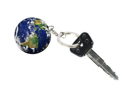 keyring: Key with Earth as a keyring  Stock Photo
