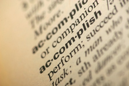 accomplish: Word accomplish in a dictionary Stock Photo