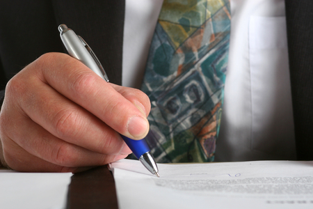 Business man siging a contract photo