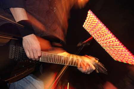 amplified: Guitarist on the stage
