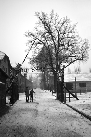 Arbeit Mach Frei (Work liberates) sing at german WWII prisoner camp Aushwitz, Poland