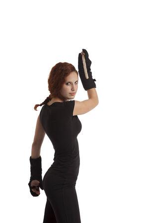 mujeres peleando: Mujer con un palo de lucha Foto de archivo