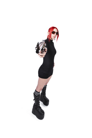 Young Dyed Hair Female Holding Gun Over White Background photo