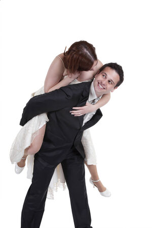 Bride Enjoying Piggyback Ride Over White Background