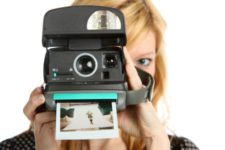 Girl with old point and shoot instant camera Imagens