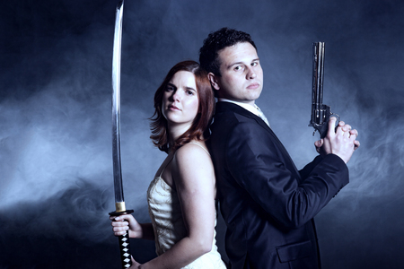 Couple with weapons photo