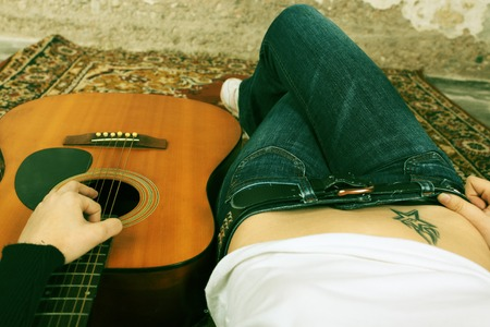 Woman with a acoustic guitar photo