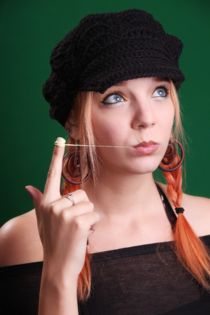Teenage girl playing with a chewing gum photo