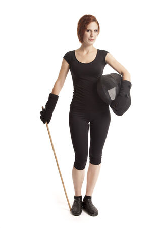 Woman with a fighting stick and a helmet. photo