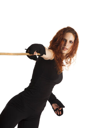 Woman with a fighting stick photo