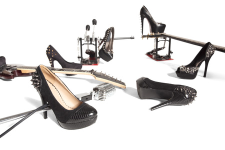 peep toe: Female shoe and musical instruments scattered over white background
