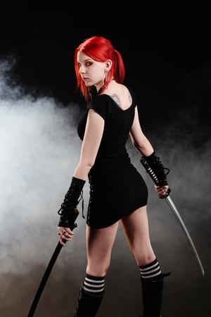 Beautiful red hair girl with katana sword photo