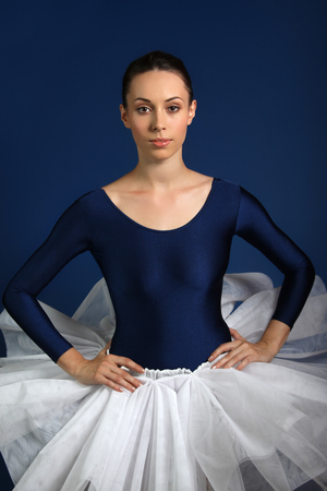 Ballerina on blue background photo