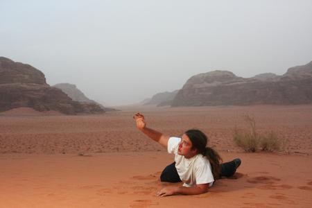 Desperate man in the desert longing for something